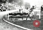 Image of Amateur runners compete in steeplechase race with obstacles United States USA, 1900, second 18 stock footage video 65675063388