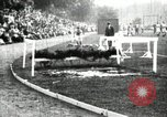 Image of Amateur runners compete in steeplechase race with obstacles United States USA, 1900, second 20 stock footage video 65675063388