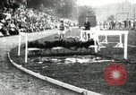 Image of Amateur runners compete in steeplechase race with obstacles United States USA, 1900, second 21 stock footage video 65675063388