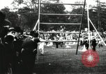 Image of Amateur runners compete in steeplechase race with obstacles United States USA, 1900, second 23 stock footage video 65675063388
