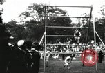 Image of Amateur runners compete in steeplechase race with obstacles United States USA, 1900, second 30 stock footage video 65675063388