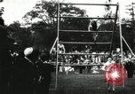 Image of Amateur runners compete in steeplechase race with obstacles United States USA, 1900, second 31 stock footage video 65675063388