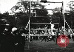 Image of Amateur runners compete in steeplechase race with obstacles United States USA, 1900, second 34 stock footage video 65675063388