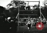 Image of Amateur runners compete in steeplechase race with obstacles United States USA, 1900, second 37 stock footage video 65675063388