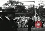 Image of Amateur runners compete in steeplechase race with obstacles United States USA, 1900, second 44 stock footage video 65675063388