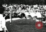 Image of Amateur runners compete in steeplechase race with obstacles United States USA, 1900, second 47 stock footage video 65675063388