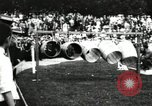 Image of Amateur runners compete in steeplechase race with obstacles United States USA, 1900, second 48 stock footage video 65675063388