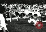 Image of Amateur runners compete in steeplechase race with obstacles United States USA, 1900, second 50 stock footage video 65675063388