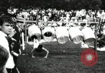 Image of Amateur runners compete in steeplechase race with obstacles United States USA, 1900, second 54 stock footage video 65675063388