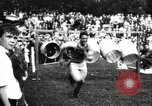 Image of Amateur runners compete in steeplechase race with obstacles United States USA, 1900, second 55 stock footage video 65675063388