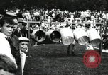 Image of Amateur runners compete in steeplechase race with obstacles United States USA, 1900, second 56 stock footage video 65675063388