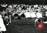 Image of Amateur runners compete in steeplechase race with obstacles United States USA, 1900, second 57 stock footage video 65675063388