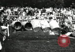 Image of Amateur runners compete in steeplechase race with obstacles United States USA, 1900, second 58 stock footage video 65675063388