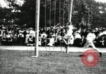 Image of Amateur runners compete in steeplechase race with obstacles United States USA, 1900, second 61 stock footage video 65675063388