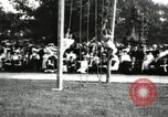 Image of Amateur runners compete in steeplechase race with obstacles United States USA, 1900, second 62 stock footage video 65675063388