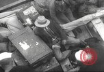Image of Refugees are brought to an American Navy ship for evacuation Europe, 1936, second 4 stock footage video 65675063410