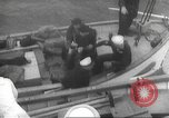 Image of Refugees are brought to an American Navy ship for evacuation Europe, 1936, second 29 stock footage video 65675063410