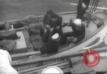 Image of Refugees are brought to an American Navy ship for evacuation Europe, 1936, second 30 stock footage video 65675063410