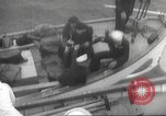 Image of Refugees are brought to an American Navy ship for evacuation Europe, 1936, second 31 stock footage video 65675063410