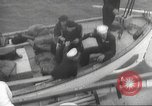Image of Refugees are brought to an American Navy ship for evacuation Europe, 1936, second 32 stock footage video 65675063410