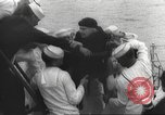 Image of Refugees are brought to an American Navy ship for evacuation Europe, 1936, second 44 stock footage video 65675063410