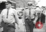 Image of police officers United States USA, 1940, second 46 stock footage video 65675063411