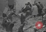 Image of search for survivors after Spanish Civil War bomb attack Spain, 1936, second 17 stock footage video 65675063415