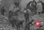 Image of search for survivors after Spanish Civil War bomb attack Spain, 1936, second 18 stock footage video 65675063415