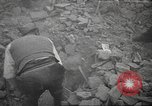 Image of search for survivors after Spanish Civil War bomb attack Spain, 1936, second 19 stock footage video 65675063415