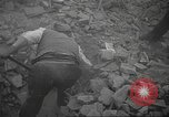 Image of search for survivors after Spanish Civil War bomb attack Spain, 1936, second 20 stock footage video 65675063415