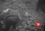 Image of search for survivors after Spanish Civil War bomb attack Spain, 1936, second 21 stock footage video 65675063415