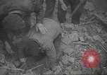 Image of search for survivors after Spanish Civil War bomb attack Spain, 1936, second 27 stock footage video 65675063415