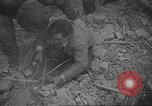 Image of search for survivors after Spanish Civil War bomb attack Spain, 1936, second 28 stock footage video 65675063415