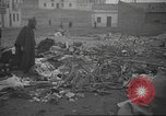 Image of search for survivors after Spanish Civil War bomb attack Spain, 1936, second 51 stock footage video 65675063415