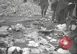 Image of search for survivors after Spanish Civil War bomb attack Spain, 1936, second 55 stock footage video 65675063415