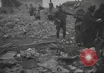 Image of search for survivors after Spanish Civil War bomb attack Spain, 1936, second 56 stock footage video 65675063415