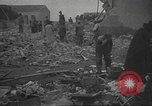 Image of search for survivors after Spanish Civil War bomb attack Spain, 1936, second 58 stock footage video 65675063415