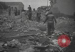 Image of search for survivors after Spanish Civil War bomb attack Spain, 1936, second 61 stock footage video 65675063415