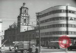 Image of traffic on streets Mexico City Mexico, 1944, second 38 stock footage video 65675063455