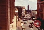 Image of Street scenes with buildings, traffic, and Aloha Tower in distance Honolulu Hawaii USA, 1942, second 4 stock footage video 65675063478