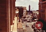 Image of Street scenes with buildings, traffic, and Aloha Tower in distance Honolulu Hawaii USA, 1942, second 6 stock footage video 65675063478