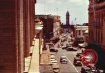 Image of Street scenes with buildings, traffic, and Aloha Tower in distance Honolulu Hawaii USA, 1942, second 7 stock footage video 65675063478