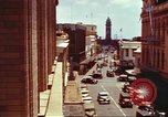 Image of Street scenes with buildings, traffic, and Aloha Tower in distance Honolulu Hawaii USA, 1942, second 8 stock footage video 65675063478