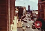 Image of Street scenes with buildings, traffic, and Aloha Tower in distance Honolulu Hawaii USA, 1942, second 9 stock footage video 65675063478