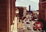 Image of Street scenes with buildings, traffic, and Aloha Tower in distance Honolulu Hawaii USA, 1942, second 10 stock footage video 65675063478