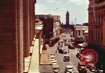 Image of Street scenes with buildings, traffic, and Aloha Tower in distance Honolulu Hawaii USA, 1942, second 13 stock footage video 65675063478