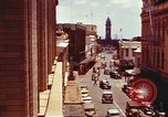 Image of Street scenes with buildings, traffic, and Aloha Tower in distance Honolulu Hawaii USA, 1942, second 14 stock footage video 65675063478