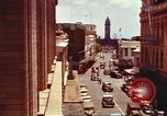 Image of Street scenes with buildings, traffic, and Aloha Tower in distance Honolulu Hawaii USA, 1942, second 15 stock footage video 65675063478