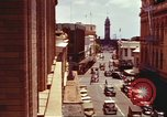 Image of Street scenes with buildings, traffic, and Aloha Tower in distance Honolulu Hawaii USA, 1942, second 16 stock footage video 65675063478