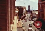 Image of Street scenes with buildings, traffic, and Aloha Tower in distance Honolulu Hawaii USA, 1942, second 17 stock footage video 65675063478